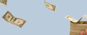 image of medical spend dollars flying